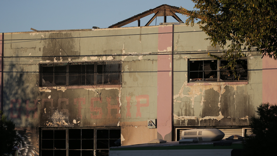 """""""Ghost Ship,"""" a warehouse and artist's space in the Fruitvale neighborhood of Oakland, Calif., burned down on Friday. It was the deadliest fire in Oakland history. (Elijah Nouvelage/Getty Images)"""