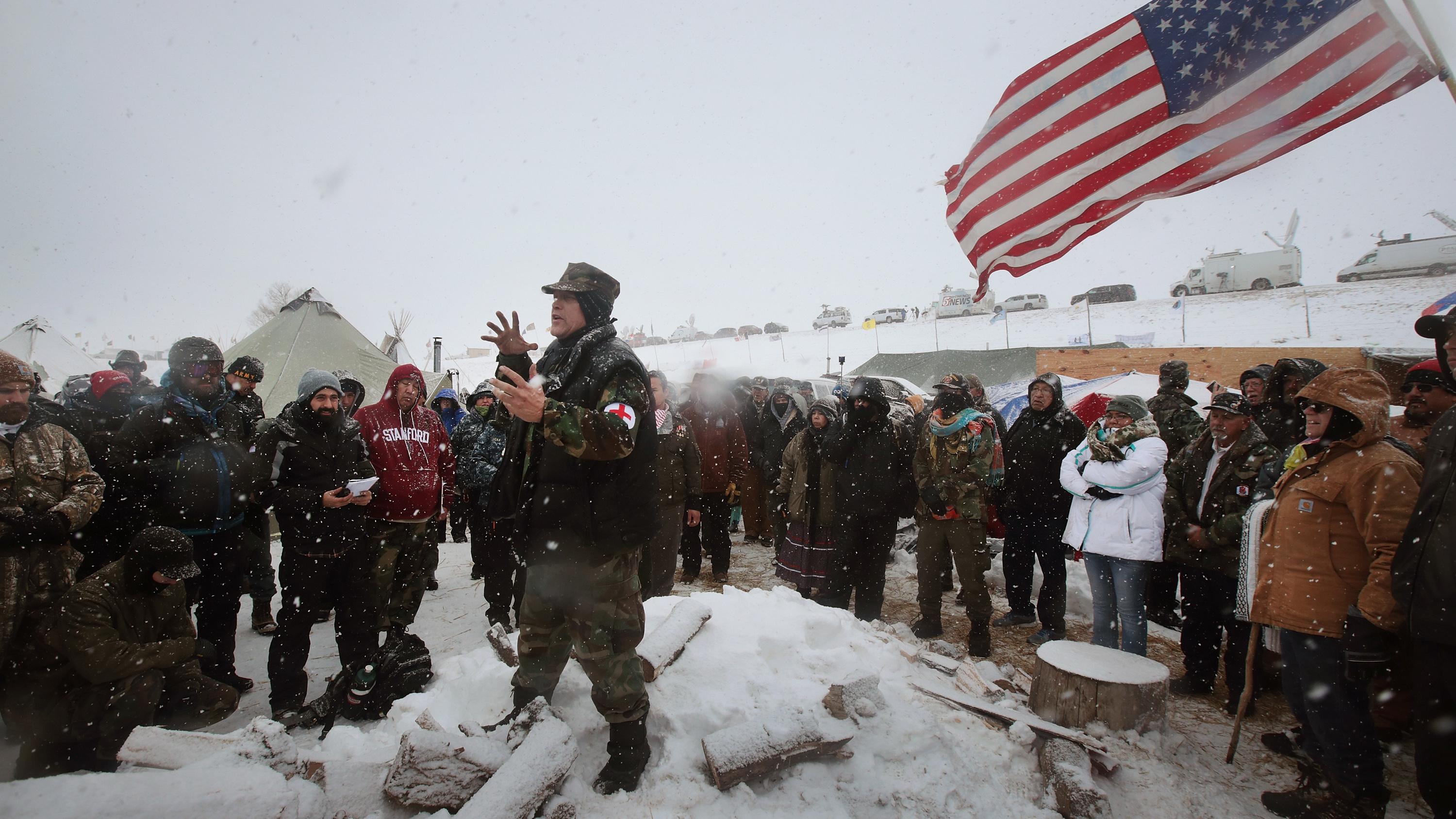 Military veterans are briefed on their role at Oceti Sakowin Camp and on cold-weather safety on Monday. Over the weekend, a group of veterans joined activists who have been trying to halt the construction of the Dakota Access Pipeline. Scott Olson/Getty Images