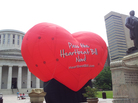 A large balloon in support of the Heartbeat Bill flies outside the Statehouse in Columbus, Ohio, in June 2012. More than four years later, the measure, which would ban abortions as soon as six weeks after conception, has passed the Legislature — after being folded into a widely supported child abuse bill.