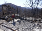 Tammy Sherrod and her husband, Scott, examine the remains of their home in the Roaring Fork neighborhood of Gatlinburg, Tenn., on Friday. Residents were getting their first look at what remains of their homes and businesses after a wildfire tore through the resort community.