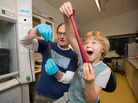 Jonathan Coleman and his son compare graphene-infused Silly Putty (left) with the unadulterated kids stuff.