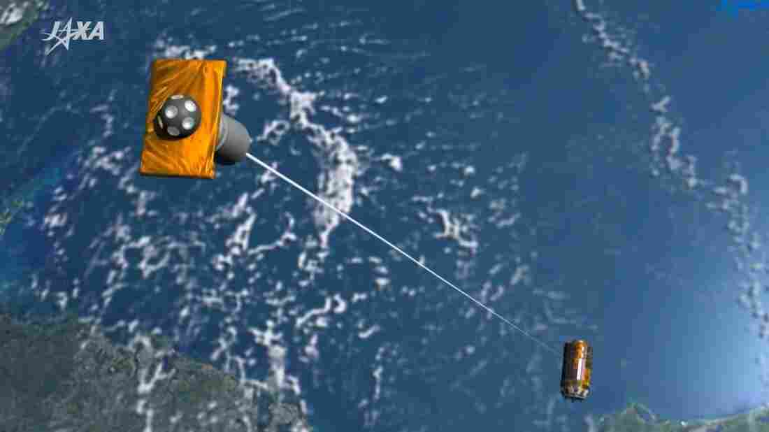 Japan launches unmanned cargo ship to remove space junk using magnetic tethers