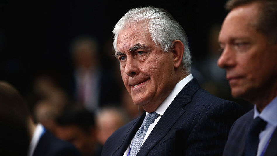 Rex Tillerson, chief executive officer of Exxon Mobile Corp., left, listens on the opening day of the St. Petersburg International Economic Forum this past June. (Bloomberg/Bloomberg via Getty Images)