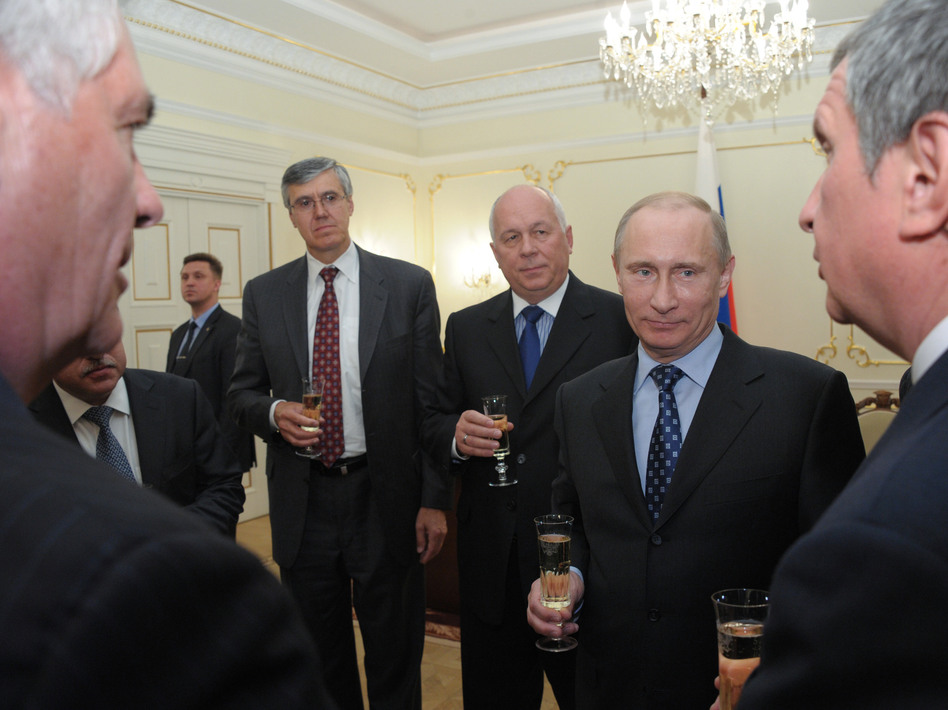 Vladimir Putin, then Russia's prime minister, toasts with ExxonMobil's Rex Tillerson (left foreground) and Igor Sechin (right foreground) outside Moscow in April 2012. Sechin, a close Putin ally, was then deputy prime minister and now serves as CEO of Russian oil giant Rosneft. (Alexei Nikolsky/AP)