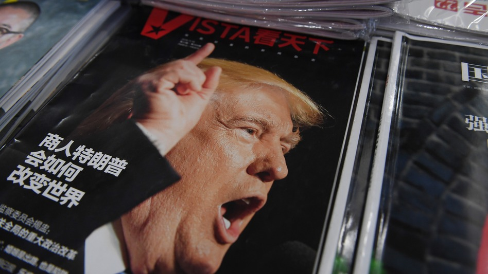 """A magazine featuring U.S. President-elect Donald Trump is seen at a bookstore in Beijing on Monday. The headline reads, """"How will businessman Trump change the world?"""" Beijing is """"seriously concerned"""" by Trump's suggestion that he could drop Washington's """"One China"""" policy, officials said Monday. (Greg Baker/AFP/Getty Images)"""