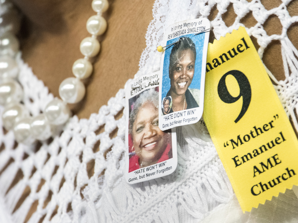 A woman at a memorial service wears tributes to two of the nine people murdered at Charleston's Emanuel African Methodist Episcopal Church, Sharonda Singleton and Ethel Lance. (Sean Rayford/Getty Images)