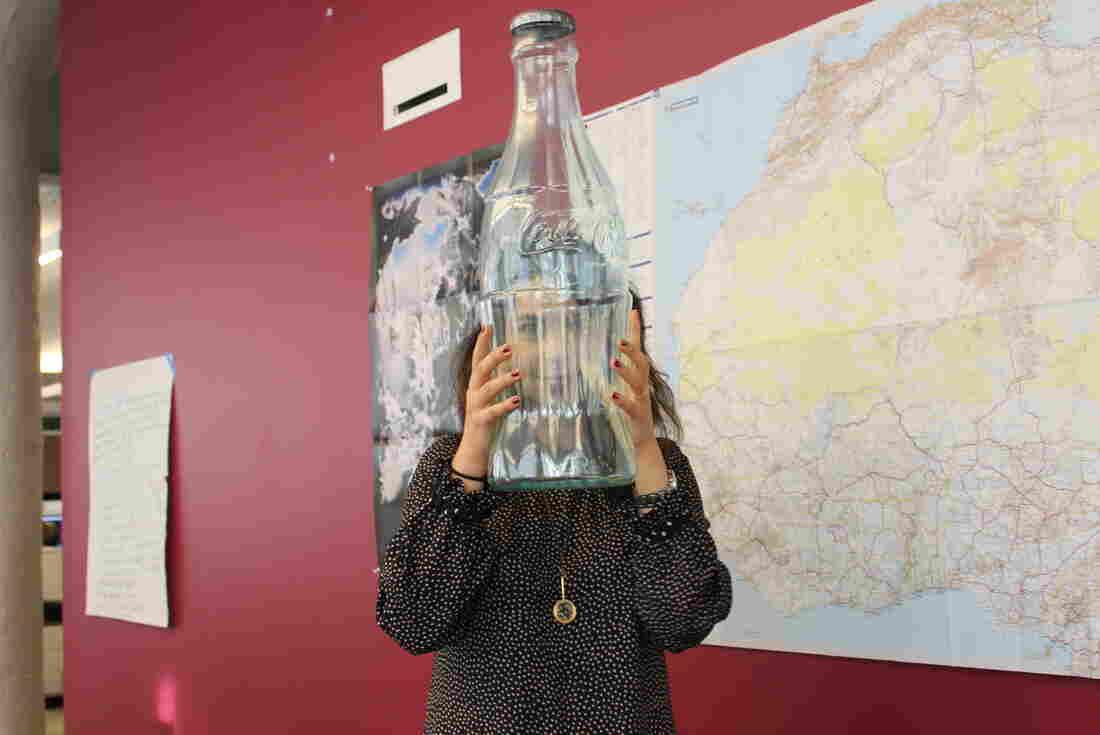 Malaka holding bottle