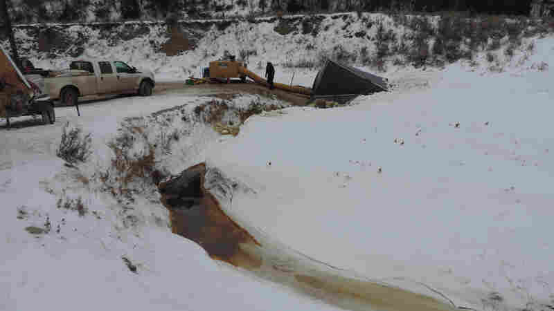 North Dakota pipeline spills into creek 150 miles from Standing Rock