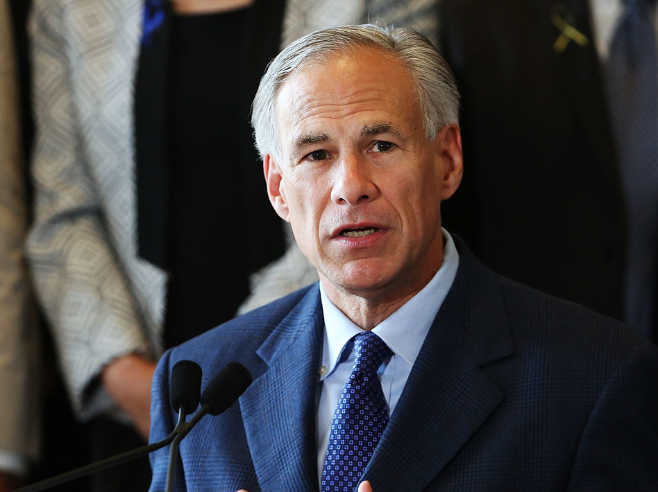 Texas Gov. Greg Abbott at Dallas' City Hall in July. Abbott has strongly endorsed new rules that would require removed fetal tissue to be buried or cremated. (Spencer Platt/Getty Images)