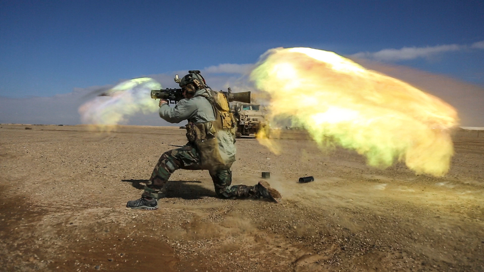 A soldier fires a Carl Gustav recoilless rifle system during weapons practice in Helmand province, Afghanistan. Heavy weapons like these generate a shock wave that may cause brain injuries. (Sgt. Benjamin Tuck/CJSOTF-A/DVIDS)