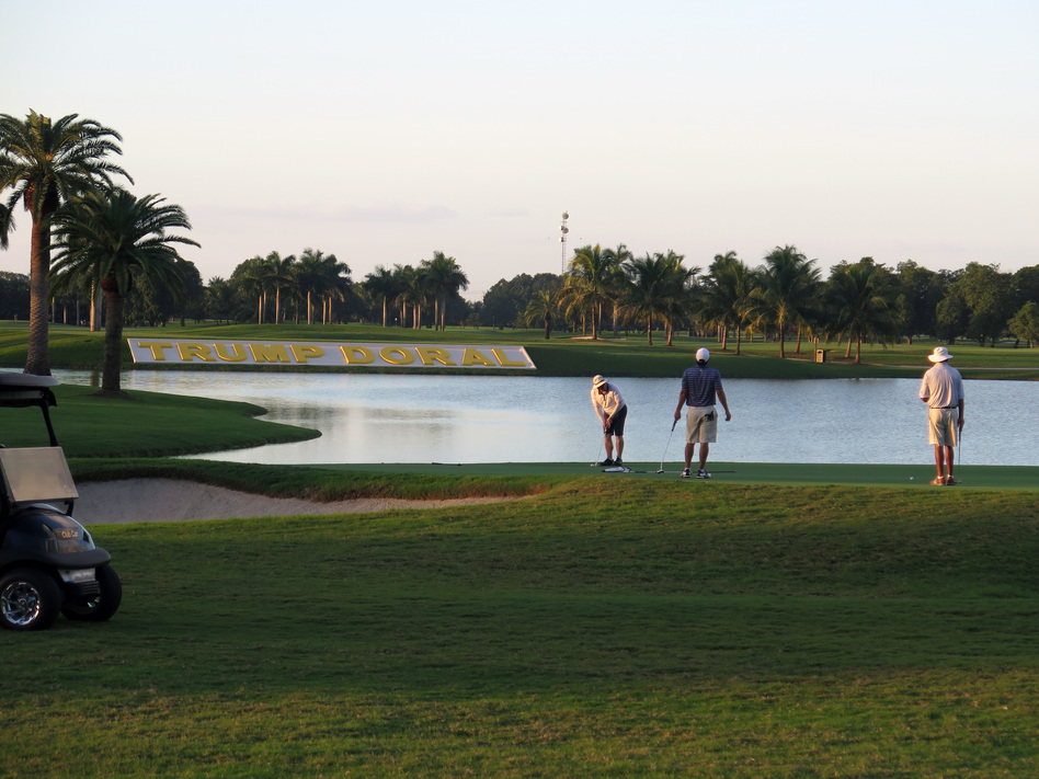 The Trump National Doral luxury resort near Miami is Donald Trump's biggest revenue generator. As president, he will be able to steer environmental and labor policies that could boost the income from his golf courses. (Greg Allen/NPR)