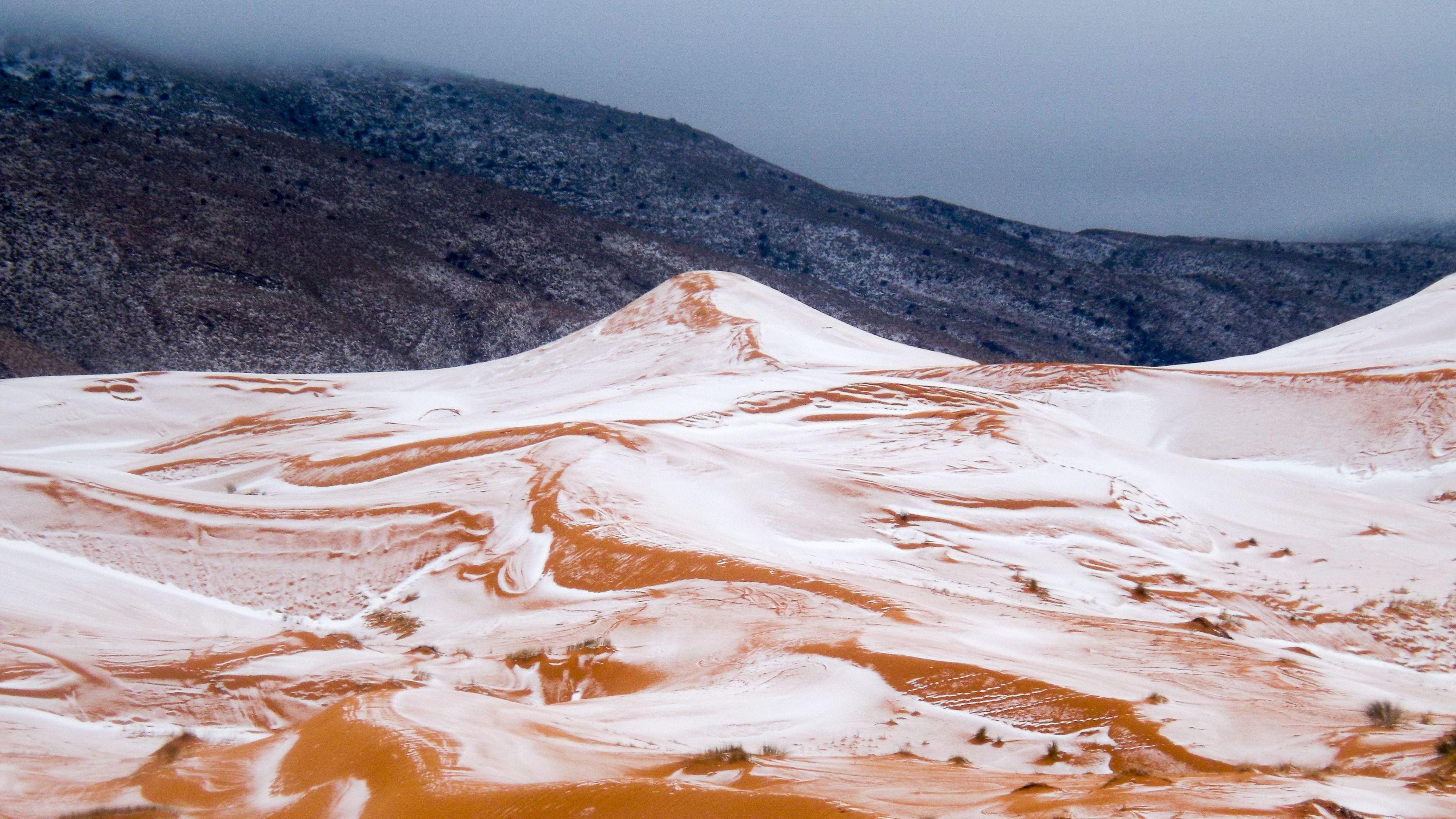 Rare Snowfall Blankets Dunes in The Sahara