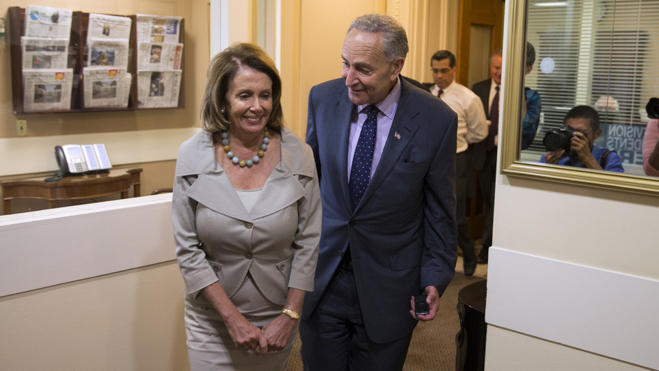 Nancy Pelosi and Chuck Schumer at a 2015 press conference. The two Democratic leaders are plotting out how to work with a Republican president and Congress next year. (Evan Vucci/AP)