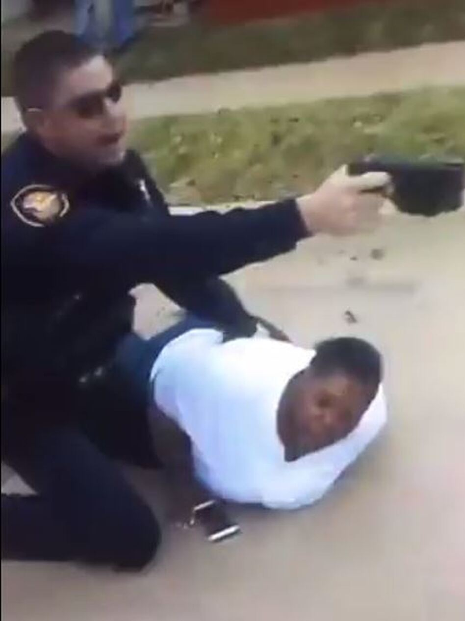 A screen grab from a video posted by Jacqueline Craig's niece shows an officer holding Craig on the ground while issuing commands. Police arrested Craig after she called to report a man had grabbed her son and accused him of littering. (Porsha Craver/Facebook)