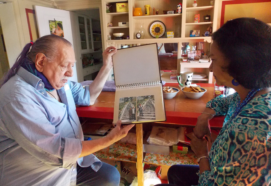Emil Girardi, 83, and Shipra Narruhn, 67, chat in Girardi's San Francisco apartment. They were paired through a nonprofit called Little Brothers, Friends of the Elderly, which aims to relieve isolation and loneliness. (Anna Gorman/KHN)