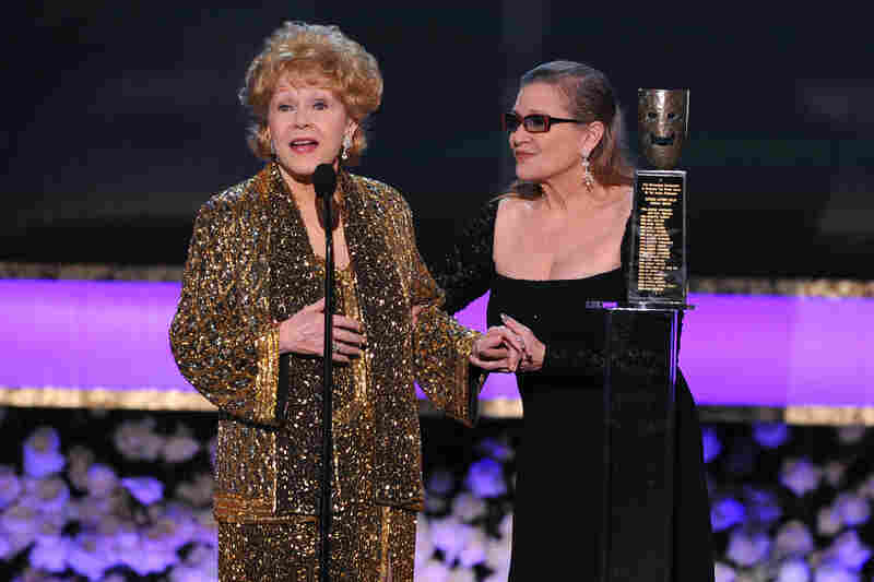 Carrie Fisher (right) presents her mother, Debbie Reynolds, with the Screen Actors Guild life achievement award at the 21st annual Screen Actors Guild Awards in 2015.