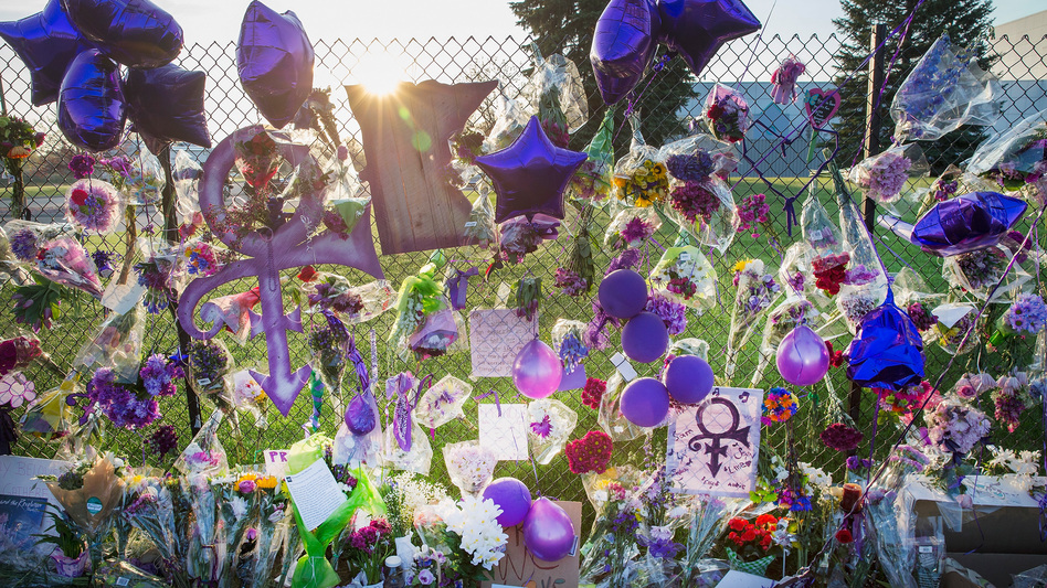 Fans leave mementos on the fence surrounding Paisley Park, Prince's home and studio in Chanhassen, Minn. (Getty Images)