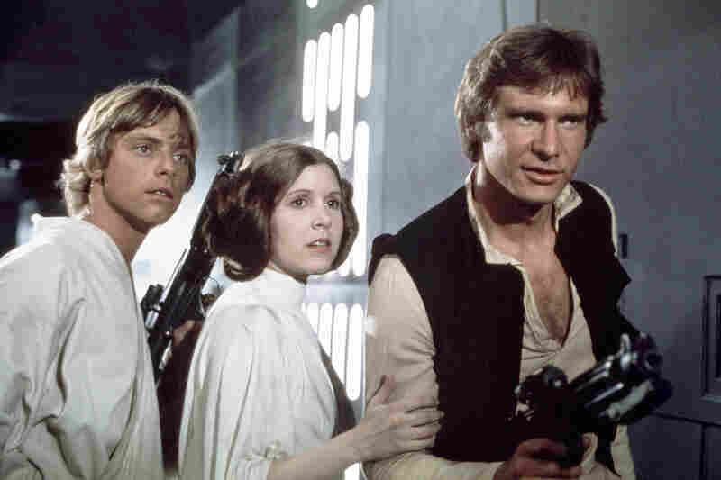 Actors Mark Hamill (from left), Carrie Fisher and Harrison Ford on the set of Star Wars: Episode IV — A New Hope.