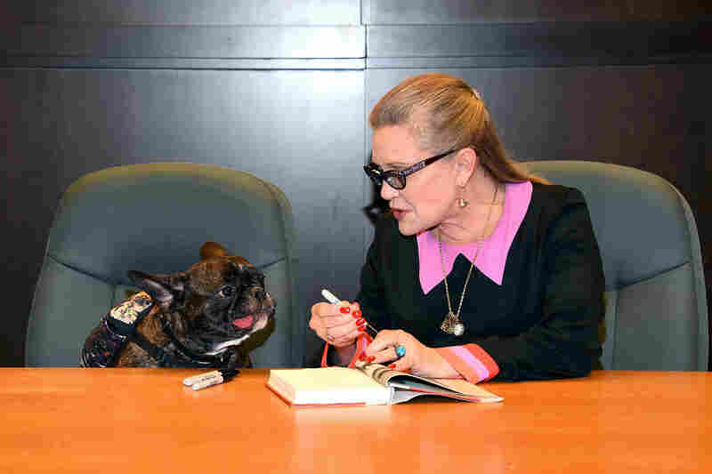 Carrie Fisher and her dog Gary Fisher sign copies of her new book The Princess Diarist at Barnes & Noble in Los Angeles in November 2016.