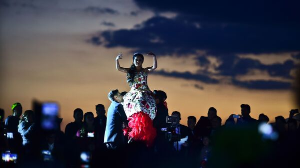 Rubi Ibarra dances during her 15th birthday celebrations in Villa Guadalupe, Mexico, on Monday.