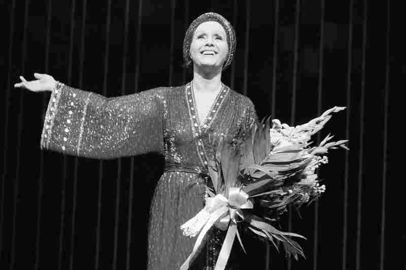 Debbie Reynolds takes a curtain call after a performance of Woman of the Year at New York's Palace Theatre in 1983.