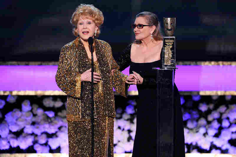 Carrie Fisher presents her mother with the Screen Actors Guild Life Achievement Award in 2015.