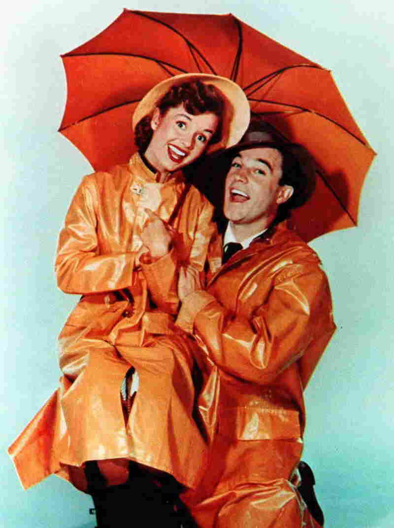 Gene Kelly and Debbie Reynolds from the movie Singin' in the Rain.