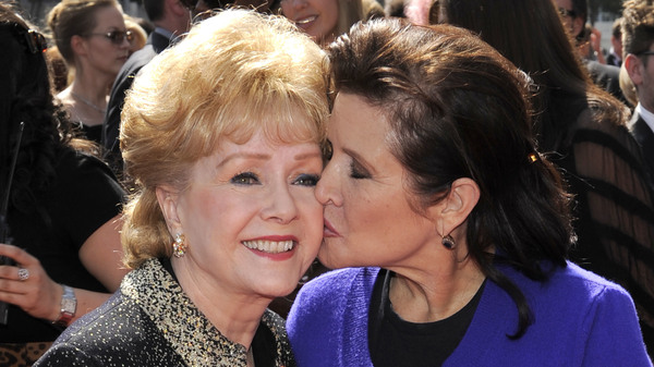 Debbie Reynolds and her daughter, Carrie Fisher, at the Primetime Creative Arts Emmy Awards in 2011 in Los Angeles. Reynolds