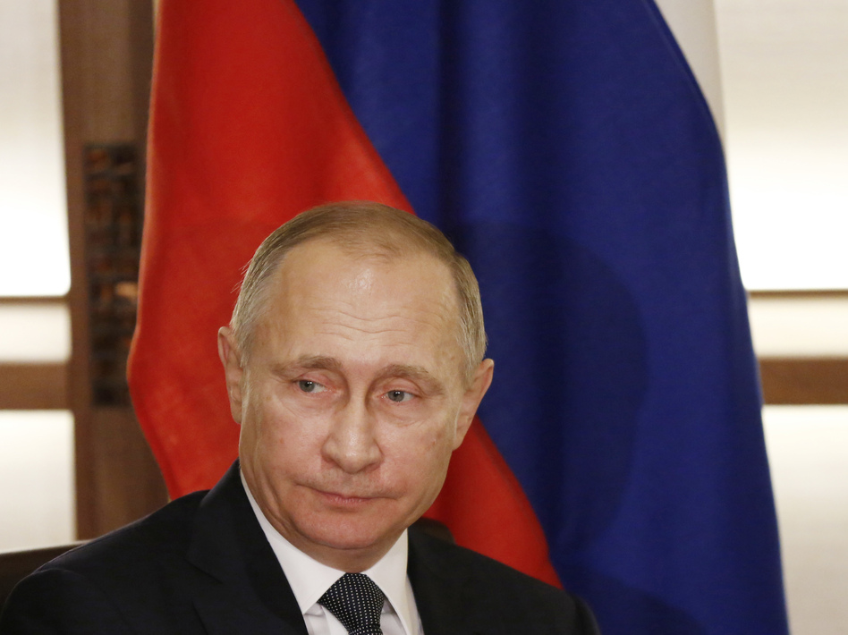 U.S. intelligence agencies maintain that Russian President Vladimir Putin personally authorized the hacking of Democratic officials'™ email accounts during the runup to the presidential election. (Toru Hanai/AP)
