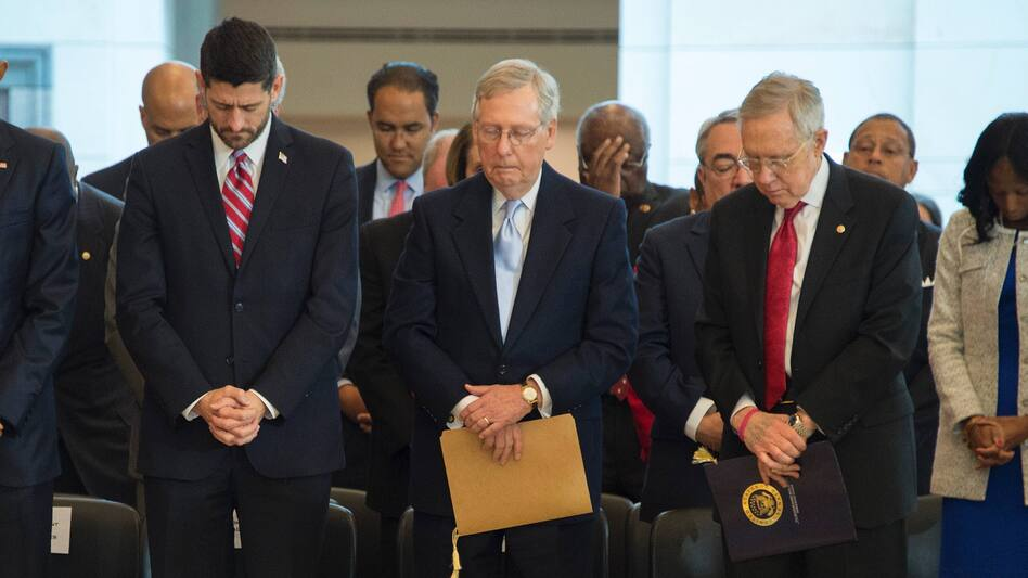 House Speaker Paul Ryan, Senate Majority Leader Mitch McConnell and Senate Minority Leader Harry Reid bow their heads in prayer in this 2015 photo. All three are Christians, as are more than 90 percent of congressional members.