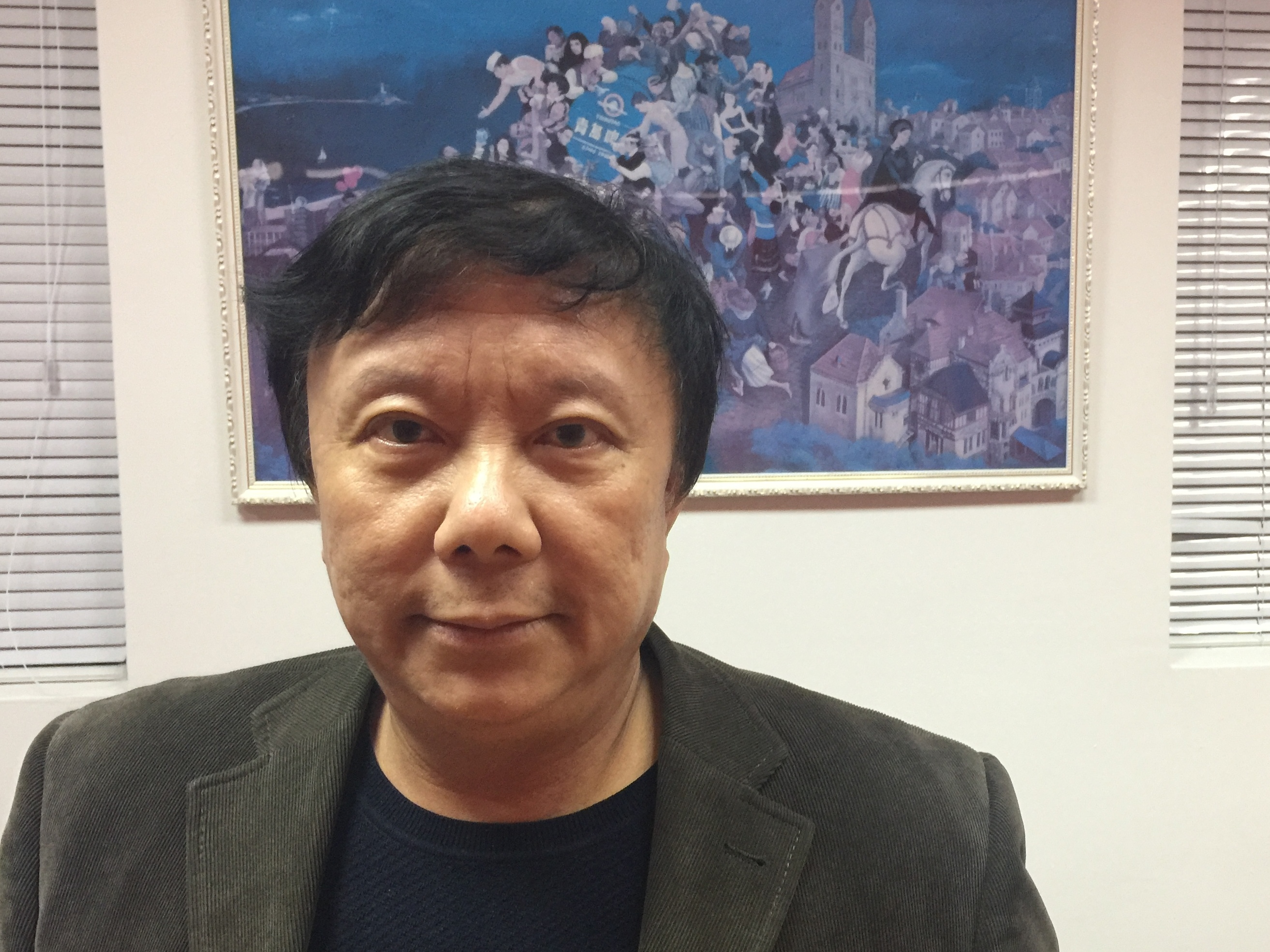 Zhu Dake is a professor at Tongji University in Shanghai. He says the Honest Shanghai app would be better if citizens could rate their own government. Rob Schmitz/NPR.