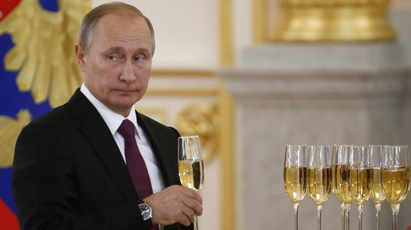 Russian President Putin holds a glass during a ceremony of receiving diplomatic credentials from foreign ambassadors in the Kremlin. President-elect Trump says he wants better relations with Putin.