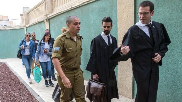 Israeli soldier Elor Azaria, who was caught on video shooting a wounded Palestinian assailant in the head as he lay on the ground, speaks with his lawyers upon his arrival for a hearing at a military appeals court in Tel Aviv on Nov. 23, 2016. Azaria has been found guilty of manslaughter.