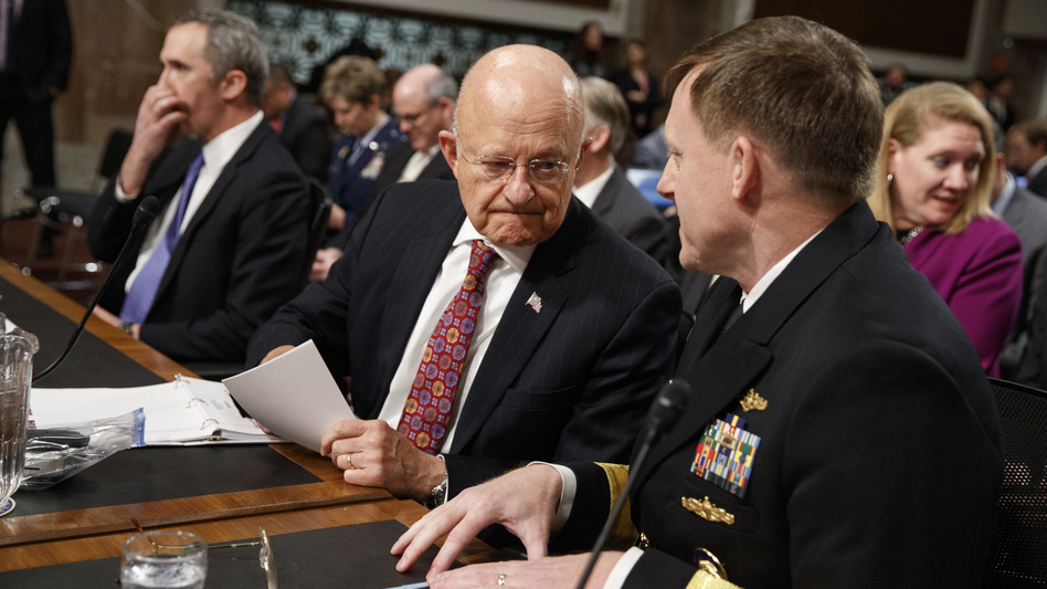 Director of National Intelligence James Clapper (center) talks with National Security Agency and Cyber Command chief Adm. Michael Rogers prior to testifying before the Senate Armed Services Committee. (Evan Vucci/AP)