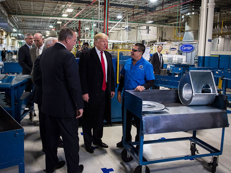 President-elect Donald Trump tours the Carrier Corp. in Indianapolis following the company's announcement it would keep hundreds of manufacturing jobs in the United States rather than move them to Mexico. (Jabin Botsford/The Washington Post/Getty Images)