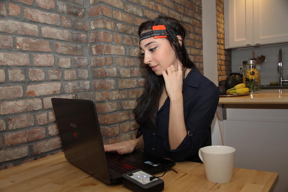 A user wears a tDCS device sold by an online retailer, Caputron.