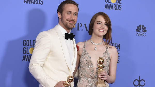 Ryan Gosling and Emma Stone pose with the award for best performance by an actor and actress in a motion picture - musical or comedy for La La Land at the 74th annual Golden Globe Awards at the Beverly Hilton Hotel on Sunday in Beverly Hills, Calif.