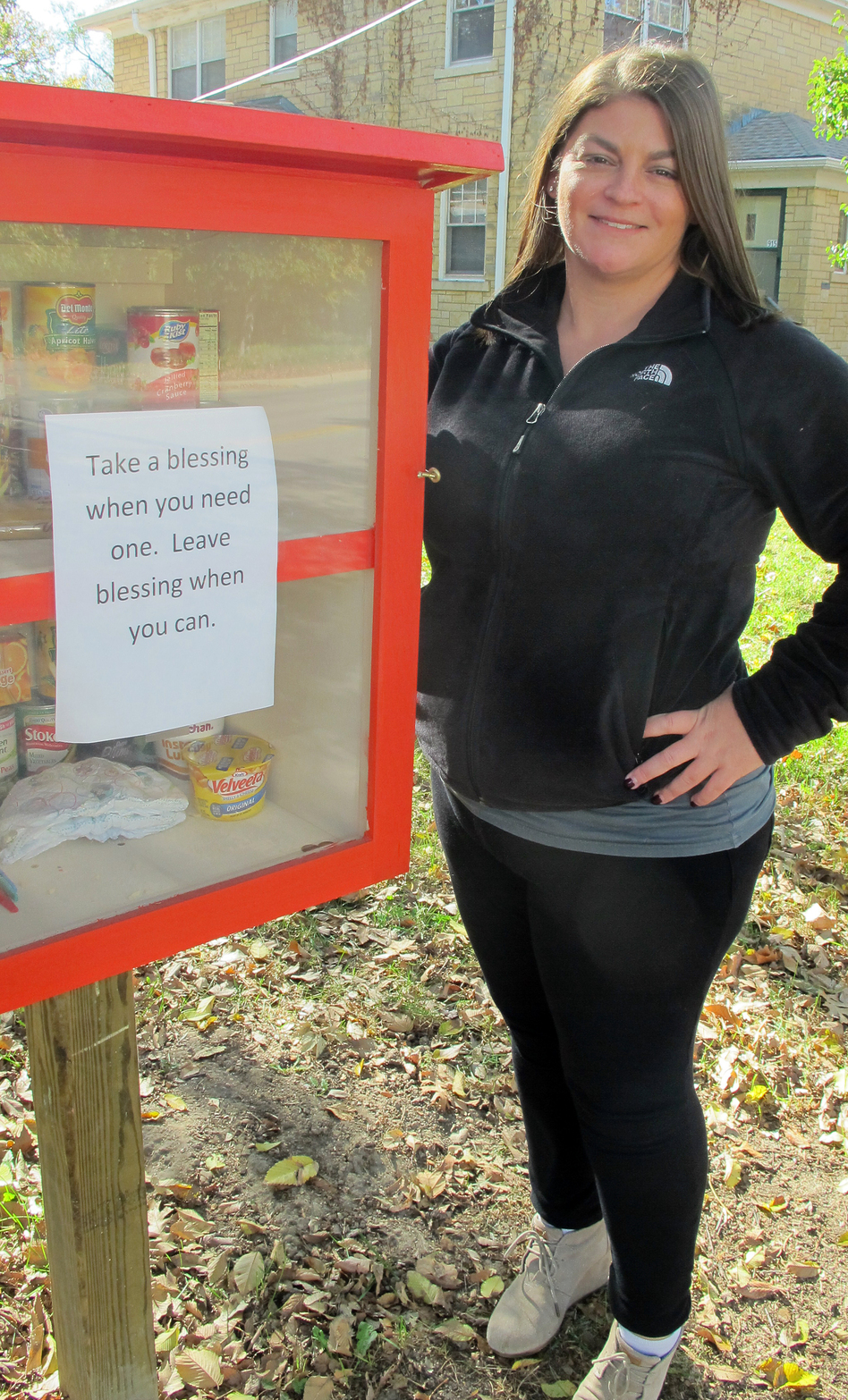 "Maggie Ballard of Wichita, Kan., and her ""blessing box"" filled with food and personal care items that she and others have donated."