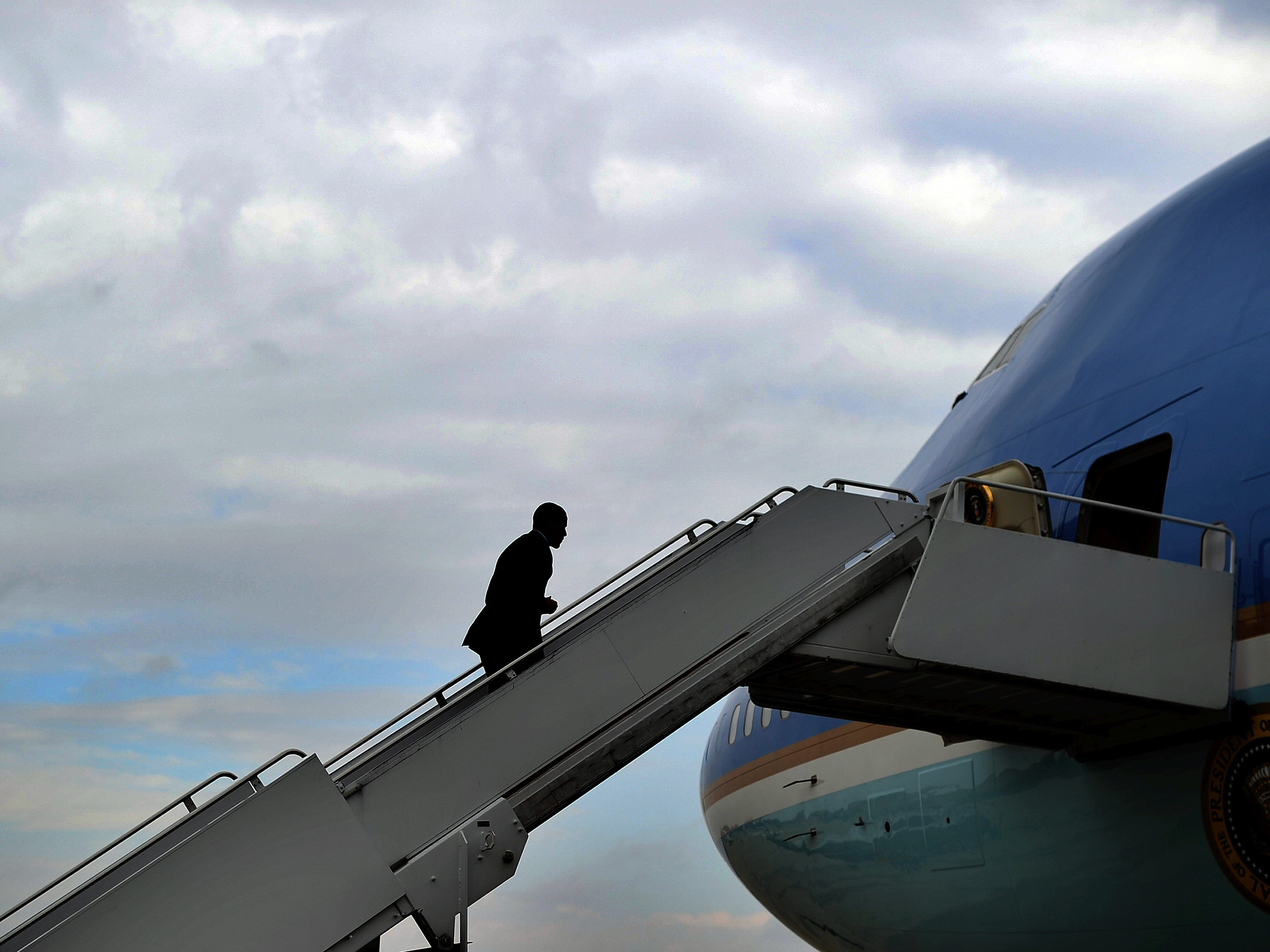 President Barack Obama boards Air Force One at Andrews Air Force Base in Maryland on October 30, 2013. President Obama will complete two terms as president next week. (JEWEL SAMAD/AFP/Getty Images)
