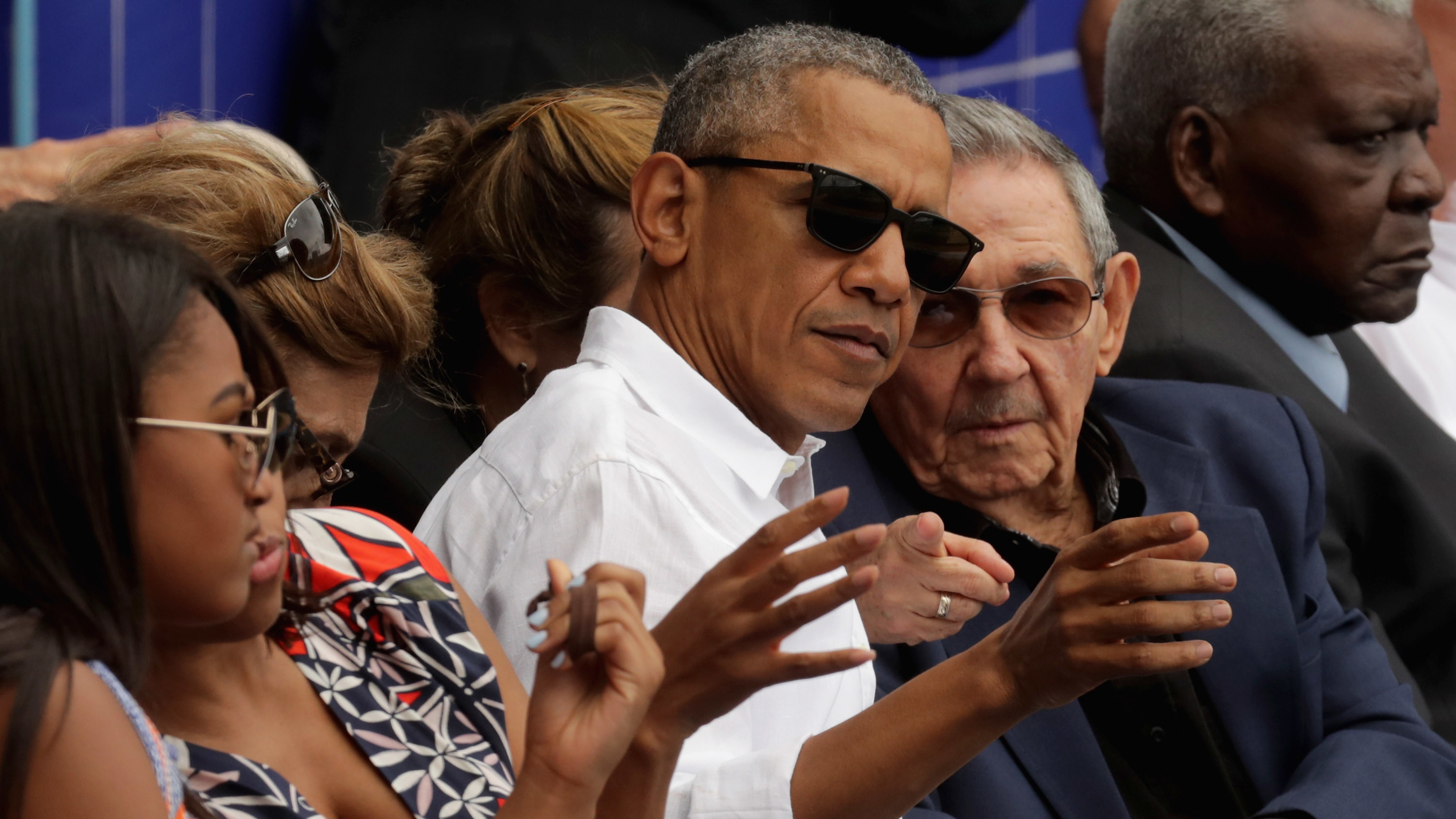 President Barack Obama and Cuban President Raul Castro visit during an exhibition game between the Cuban national team and the Major League Baseball team Tampa Bay Devil Rays at the Estado Latinoamericano March 22, 2016 in Havana, Cuba. (Chip Somodevilla/Getty Images)