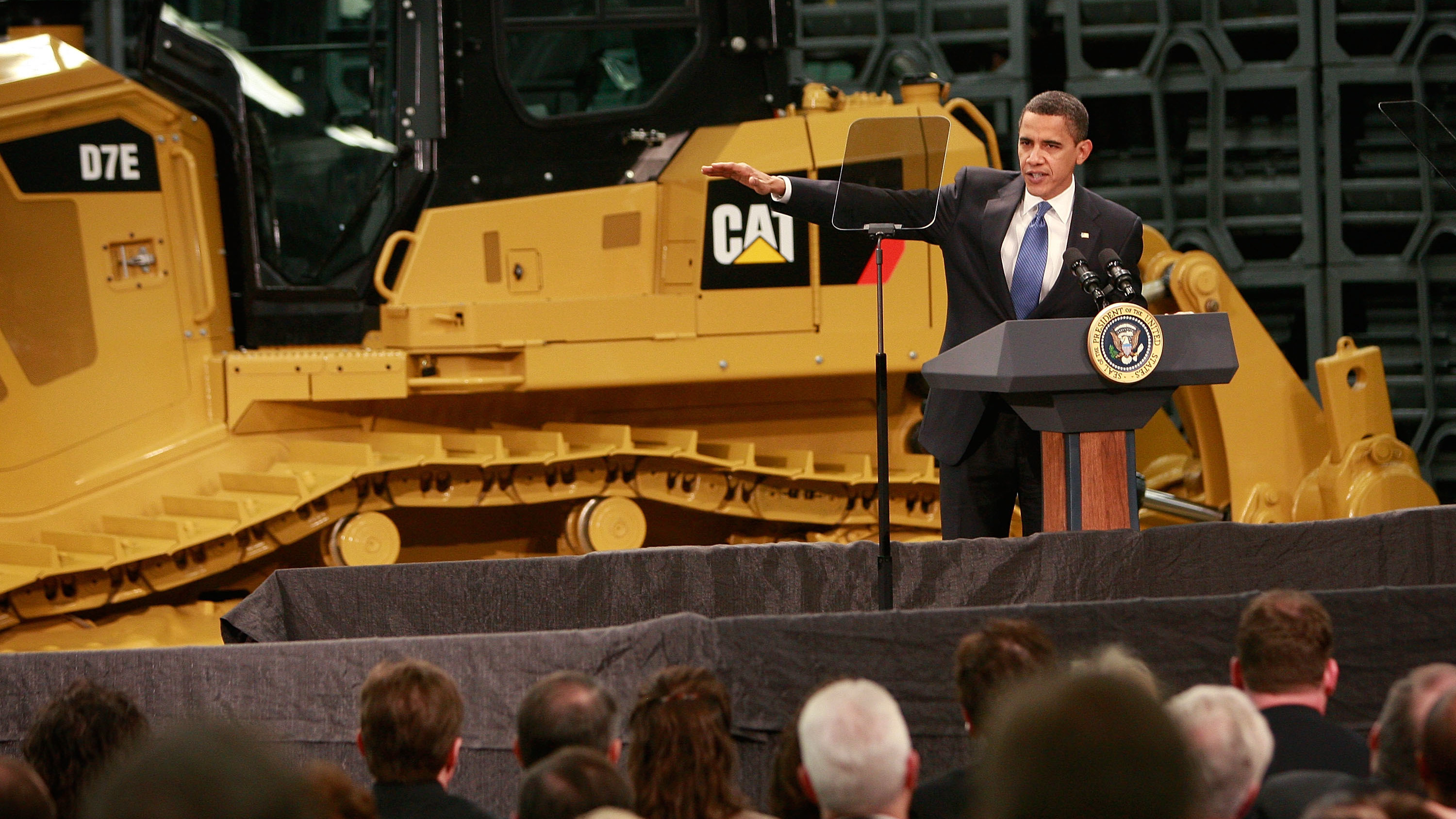 President Barack Obama speaks to workers at a Caterpillar plant about creating jobs and stimulating the economy on February 12, 2009 in East Peoria, Illinois. Stung by the global recession, Caterpillar announced in January it would cut more than 20,000 jobs. (Scott Olson/Getty Images)