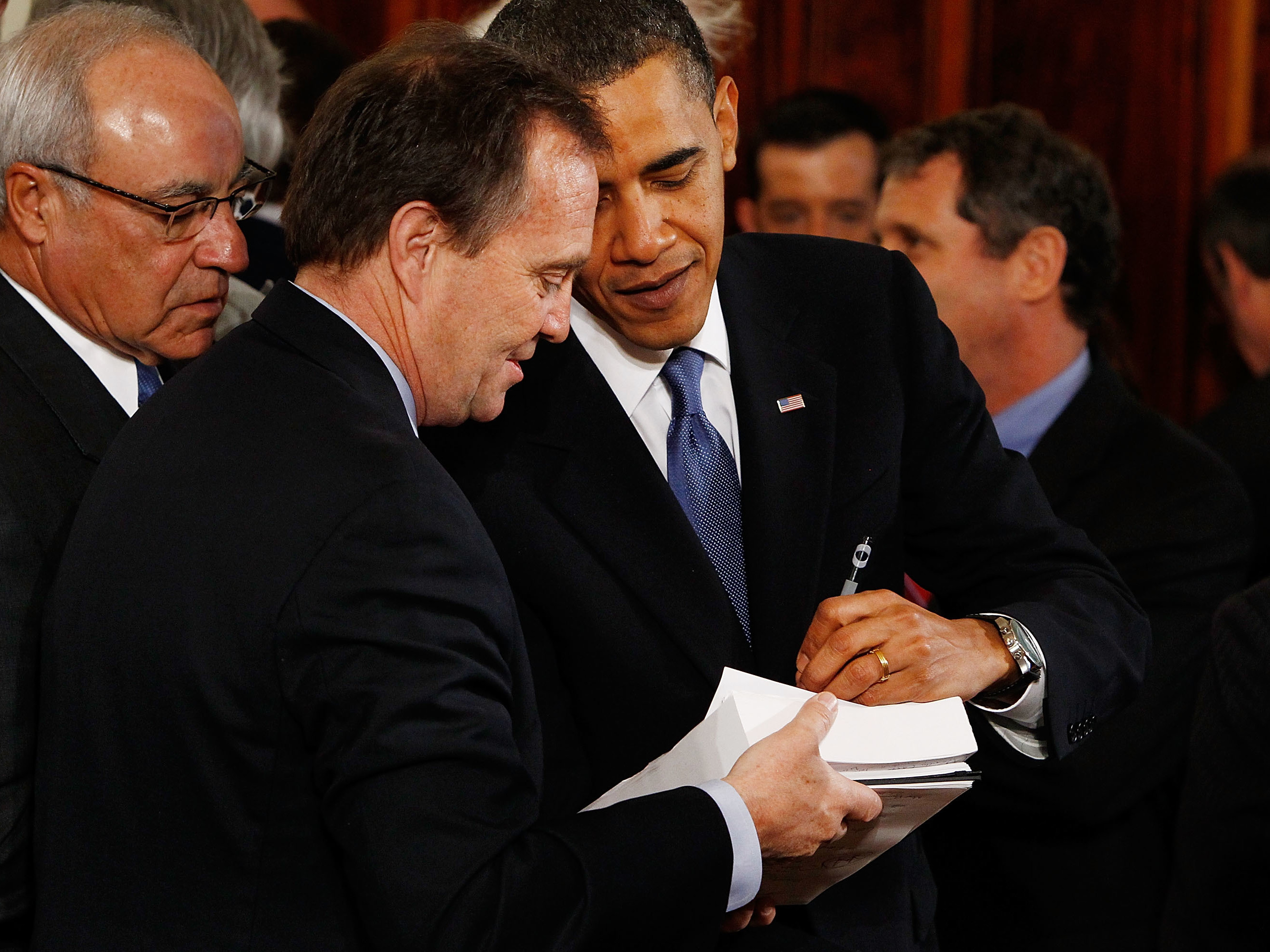 President Barack Obama signs a copy of the Affordable Health Care for America Act for a member of Congress after signing the acutual bill during a ceremony in the East Room of the White House March 23, 2010 in Washington, DC. (Chip Somodevilla/Getty Images)