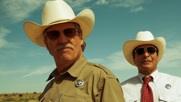 Jeff Bridges (shown with Gil Birmingham) plays an aging Texas ranger investigating a series of small-town bank robberies in Hell or High Water.