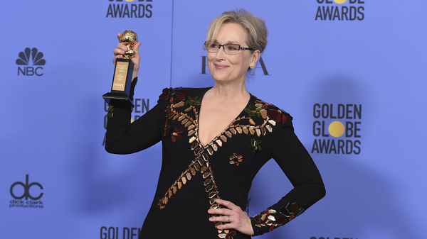 Actor Meryl Streep poses in the press room with the Cecil B. deMille Award at the 74th annual Golden Globe Awards in Beverly Hills, Calif. Earlier, when accepting the award, Streep was harshly critical of President-elect Donald Trump.