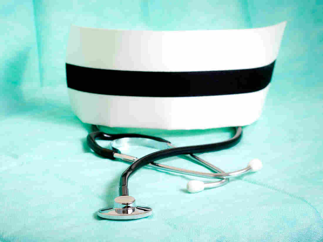 Nurse's cap and stethoscope.