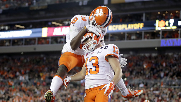 Wide receiver Hunter Renfrow of the Clemson Tigers celebrates with wide receiver Deon Cain after a 24-yard touchdown pass in Monday night