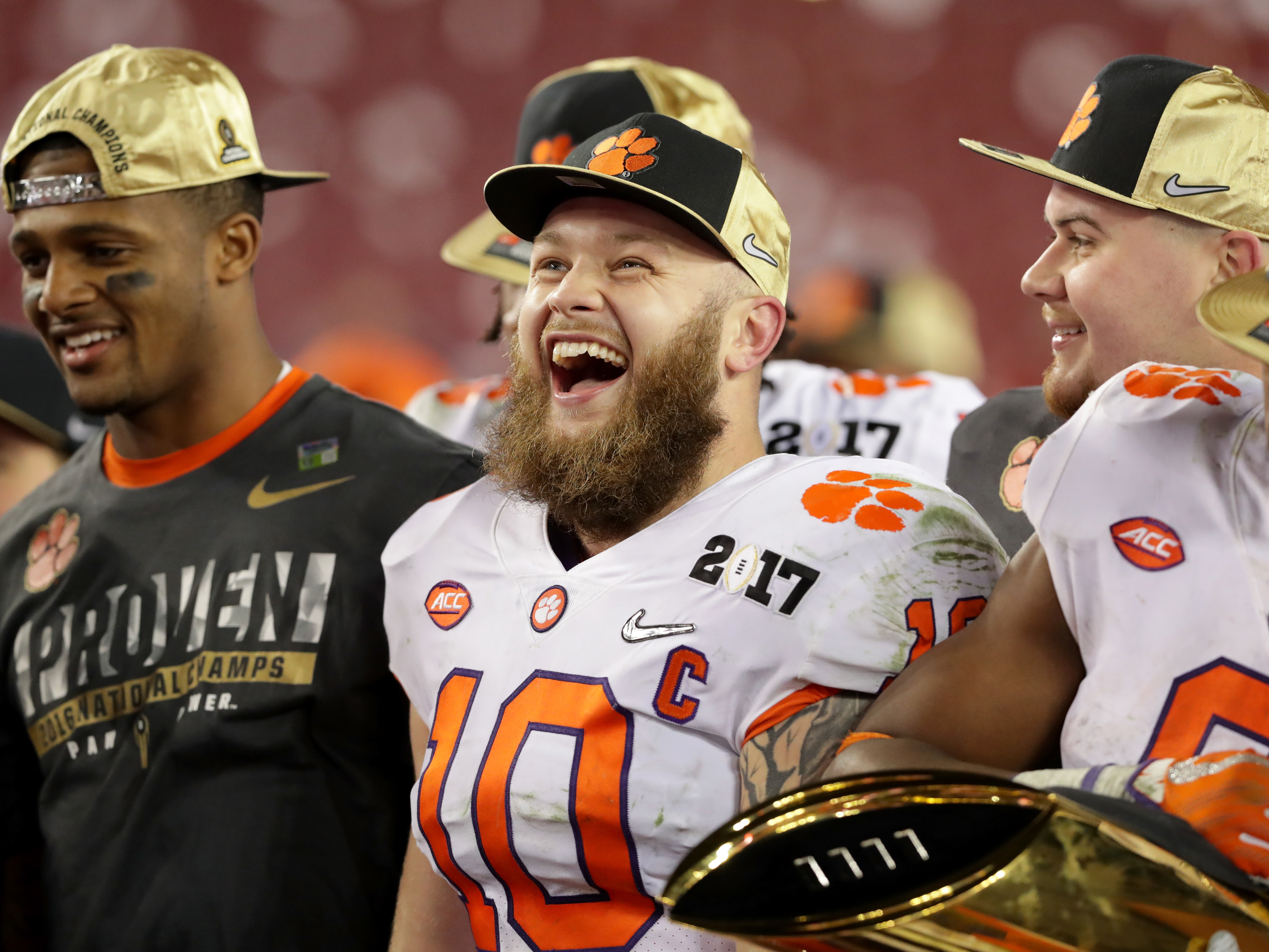 Clemson Tigers linebacker Ben Boulware, center, celebrates after his team defeated the Alabama Crimson Tide 35-31 to win the 2017 College Football Playoff National Championship Game. (Streeter Lecka/Getty Images)