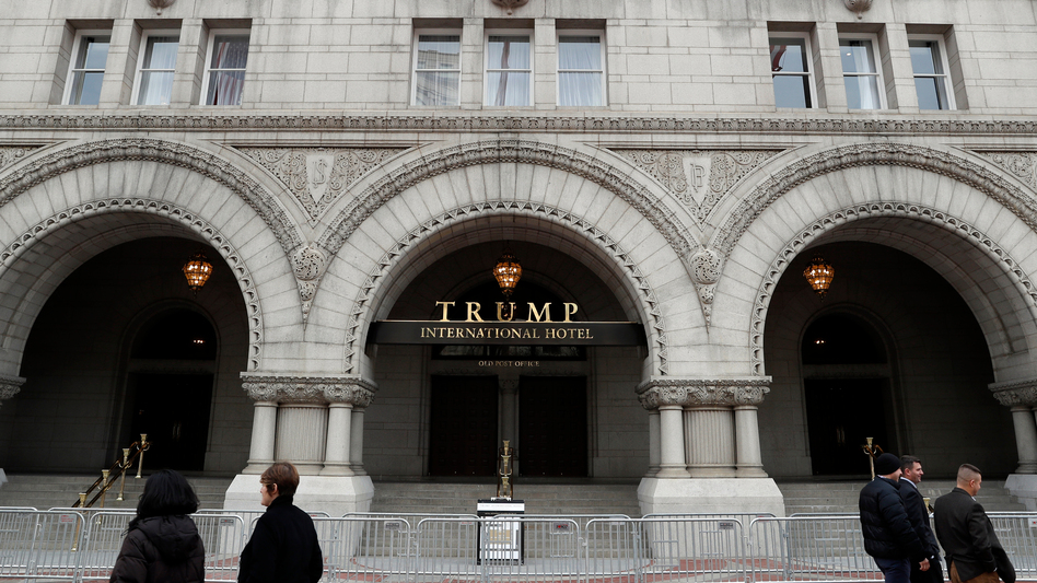 The recently opened Trump International Hotel on Pennsylvania Avenue in Washington, D.C., is one of many properties that would lose the Trump name if the president-elect followed the advice of the Office of Government Ethics and divested his business holdings. (Alex Brandon/AP)