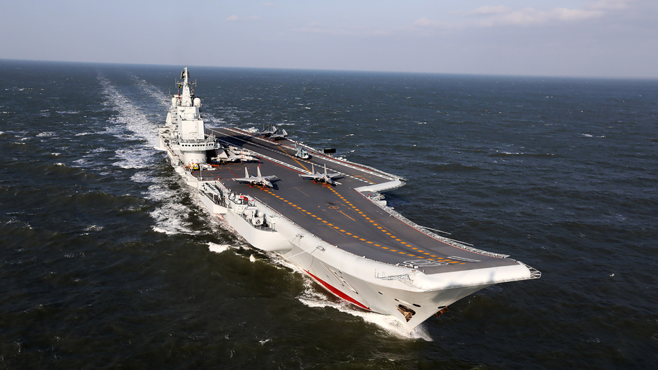 The Liaoning, China's only aircraft carrier, sails during military drills in the Pacific on Dec. 24. Taiwan's defense minister warned on Dec. 27 that enemy threats were growing daily after China's aircraft carrier and a flotilla of other warships passed south of the island in an exercise. On Wednesday, the carrier traveled through the Taiwan Strait. (AFP/Getty Images)