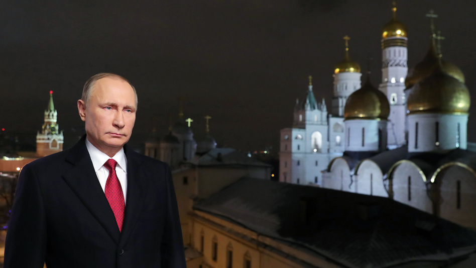 Russian President Vladimir Putin is shown at the Kremlin in Moscow during the recording of his recent New Year's message. Putin's spokesman said Wednesday that the Russian government does not gather compromising material, or <em>kompromat,</em> on political rivals, despite a well-documented history of such behavior. (Mikhail Klimentyev/AP)